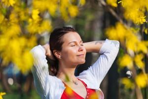 Woman enjoying sunshine in the spring