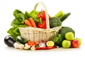 raw vegetables in wicker basket isolated on white